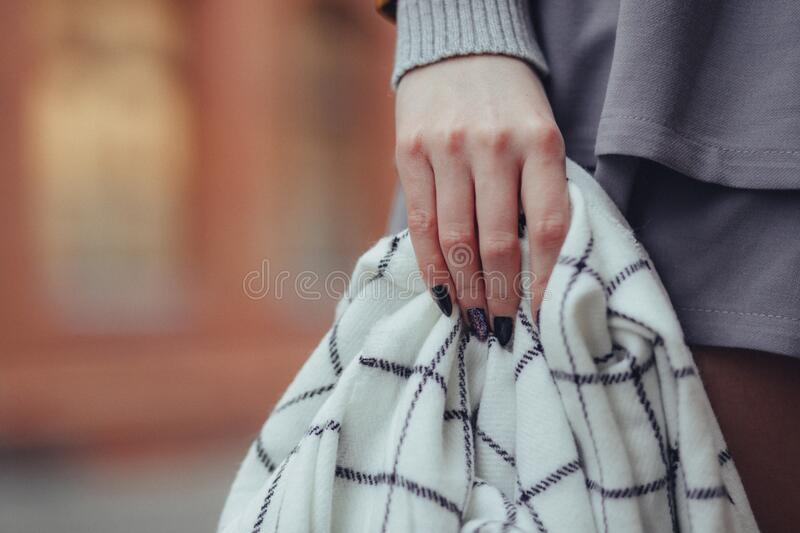 Woman Holding Sweater royalty free stock photos
