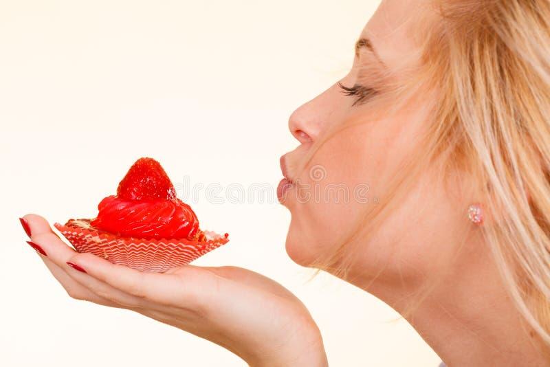 Woman holding sweet strawberry cupcake royalty free stock image