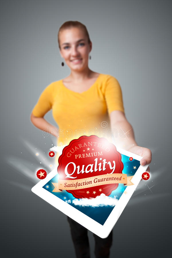 Download Woman Holding Tablet With Red Quality Label In Clouds Stock Photo - Image: 31006350
