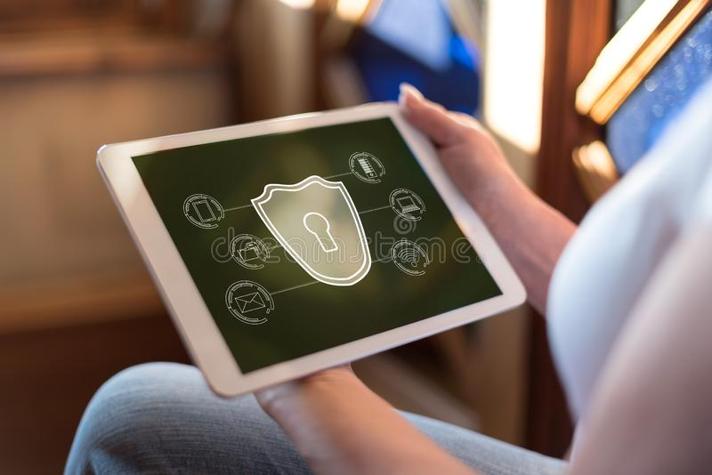 Cyber security concept on a tablet. Woman holding a tablet showing cyber security concept stock photo