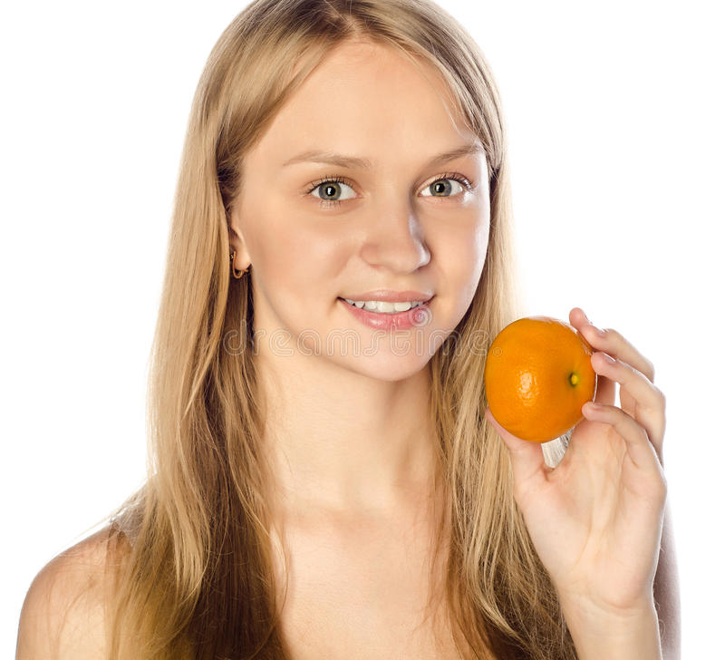 Download Woman holding a tangerine stock photo. Image of half - 25207306