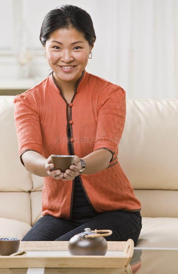 Woman Holding Tea stock photography
