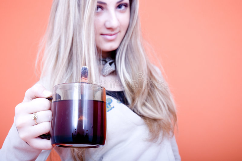 Woman holding tea cup stock image
