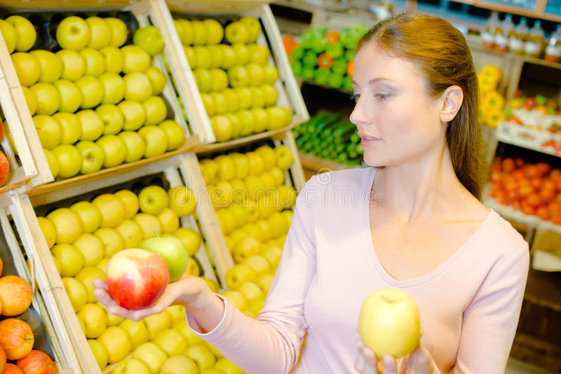 Woman holding three apples in hands royalty free stock photography