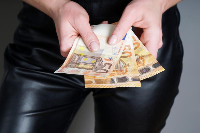 Woman holding three fifty euro banknotes or bills in her hands royalty free stock photos