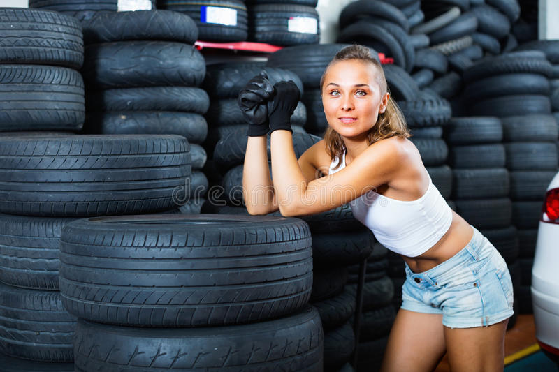 Woman holding tool in hands and working with auto in service poi stock images