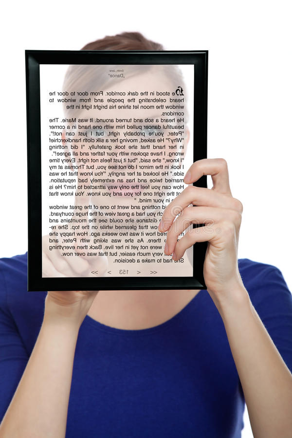 Woman holding a touchpad pc showing an E-Book stock photo
