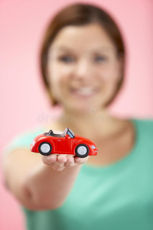 Woman Holding Toy Car royalty free stock images