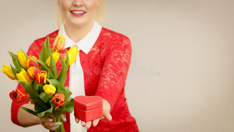 Woman holding tulips and gift stock images