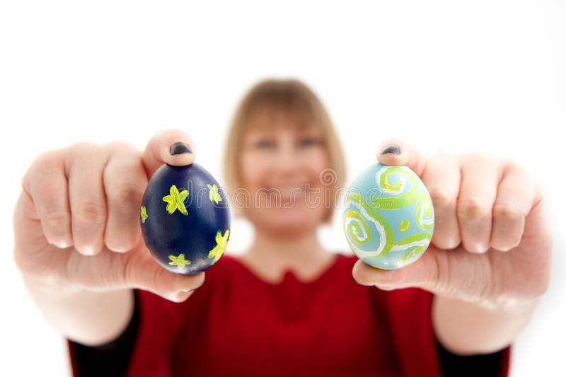 Woman Holding Two Easter Eggs stock photography