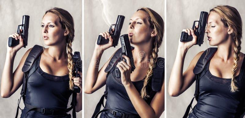 Woman holding two hand gun stock photo