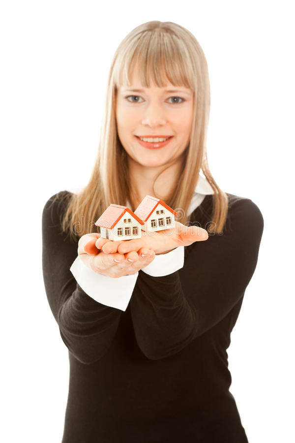 Woman Holding Two House (focus On House) Royalty Free Stock Photography
