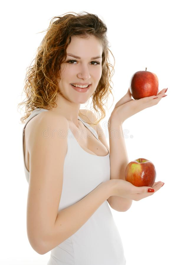 Woman holding two red apples royalty free stock photography