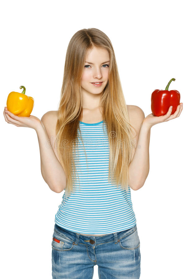 Woman holding two sweet pepper stock photos