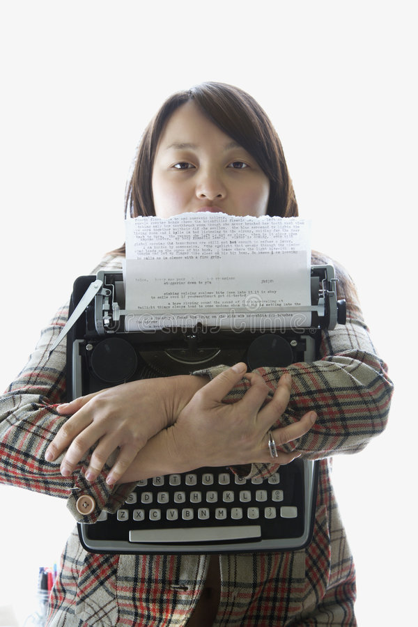 Woman holding typewriter. royalty free stock images