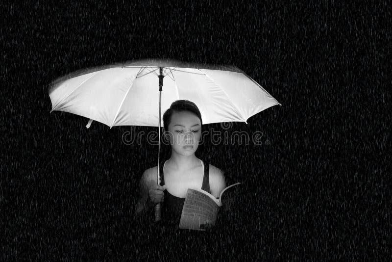 Woman Holding an Umbrella Greyscale Photo stock photo