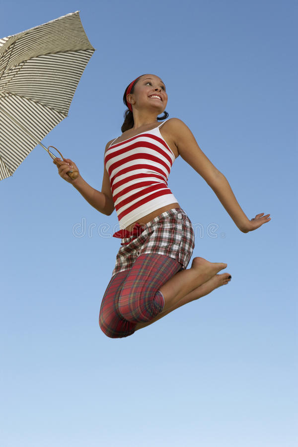Woman Holding Umbrella In Midair Royalty Free Stock Photo