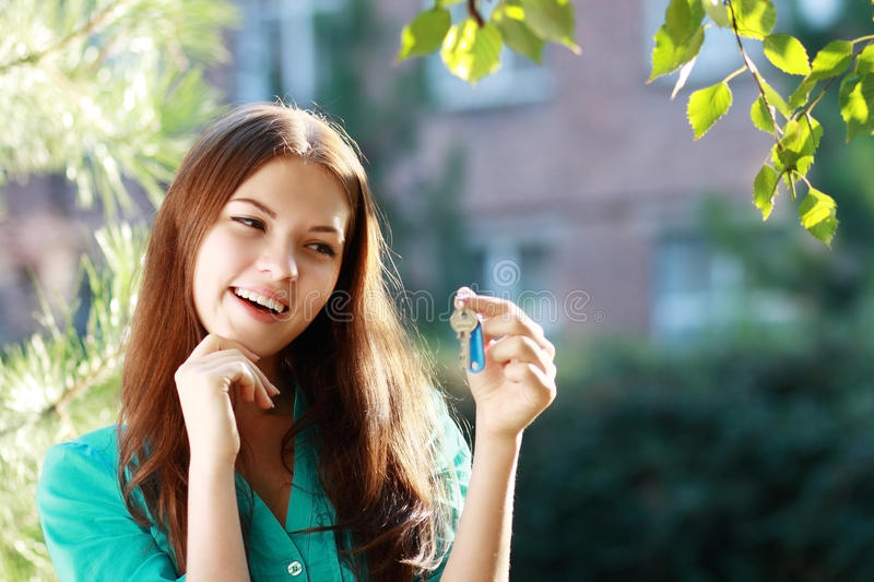 Woman Holding Up A Set Of Keys Royalty Free Stock Photography