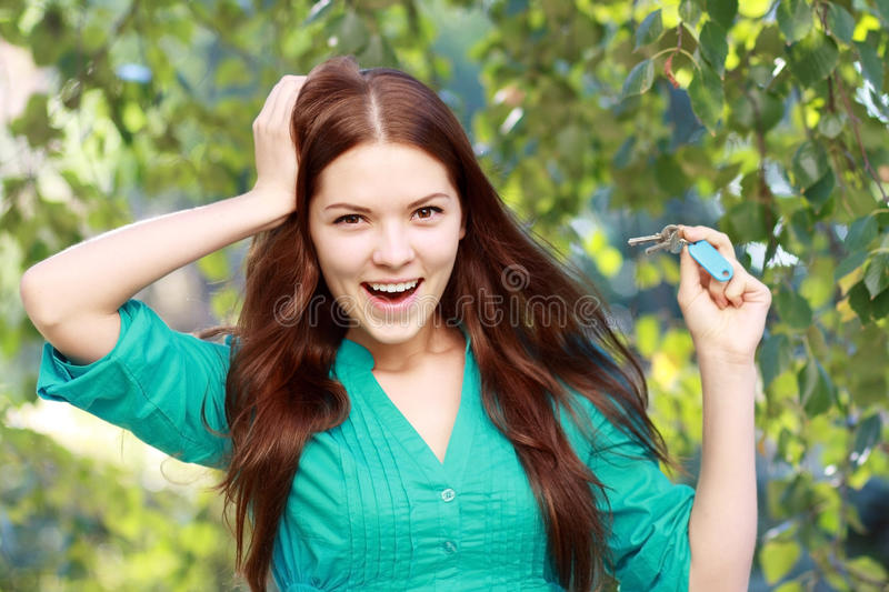 Woman Holding Up A Set Of Keys Royalty Free Stock Photo