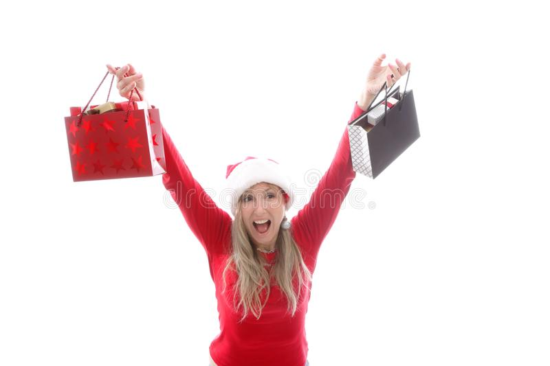 Woman holding Christmas shopping bags royalty free stock photography
