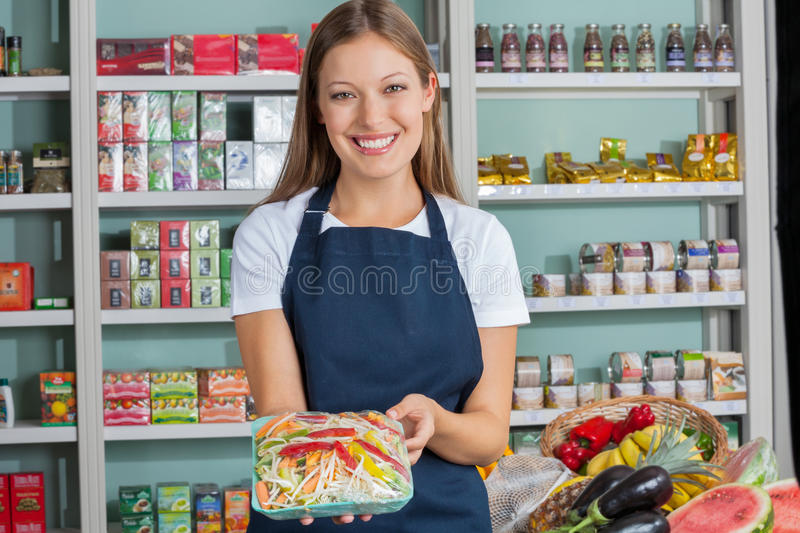 Download Woman Holding Vegetable Packet In Supermarket Stock Image - Image: 37112361
