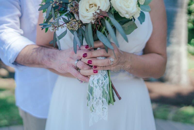Woman Holding White Bouquet stock photos