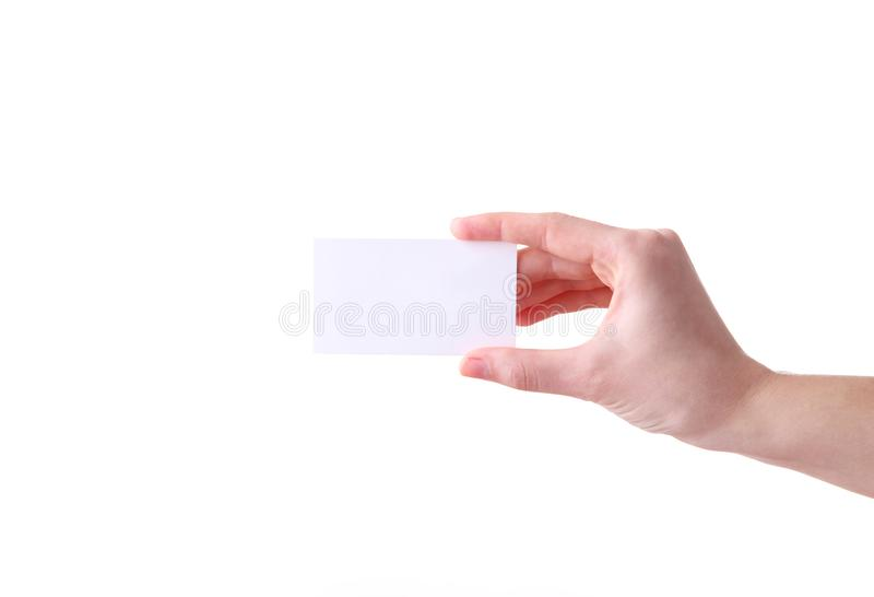 Woman holding white business card in hand isolated on a white background stock photography