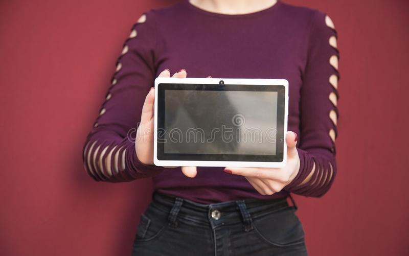 Woman holding white digital tablet stock photo
