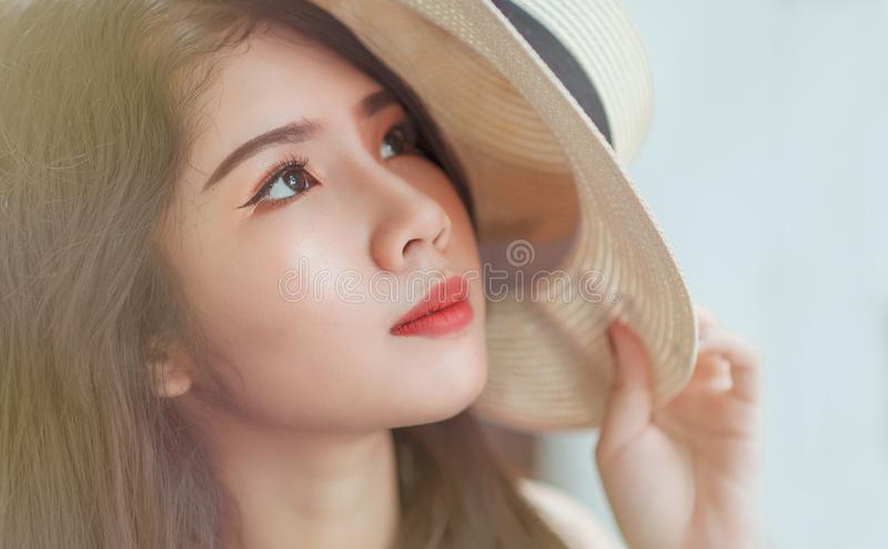 Woman Holding White Hat royalty free stock photos