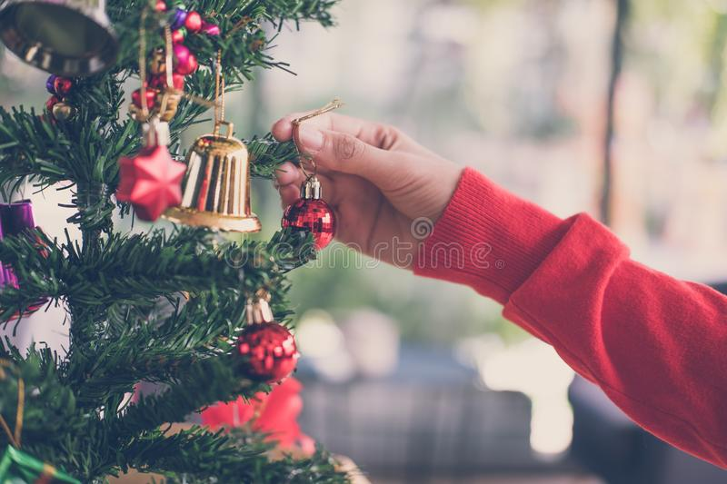 woman holding xmas ornament. girl decorate Christmas tree in a h royalty free stock photography