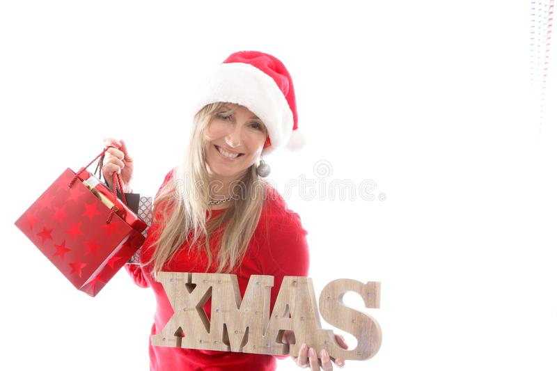 Woman holding Xmas sign and shopping bags royalty free stock photos