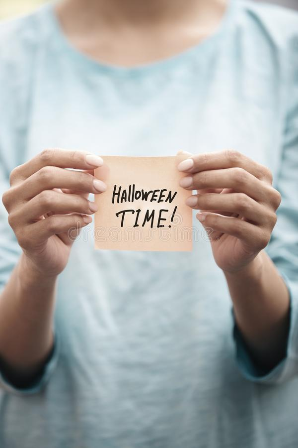 Halloween time text on a sticky paper royalty free stock image