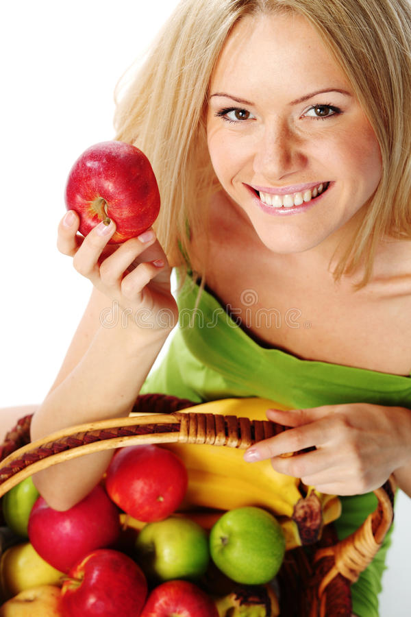 Download Woman Holds A Basket Of Fruit Royalty Free Stock Image - Image: 19365626