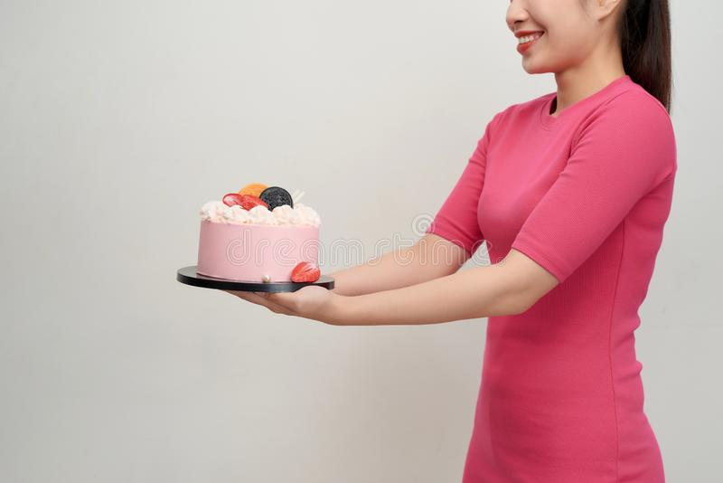 Woman holds birthday cake in her hands.  royalty free stock images