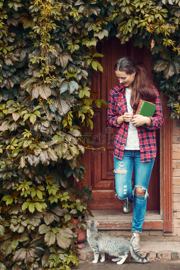 Woman holds books and walk stock photo