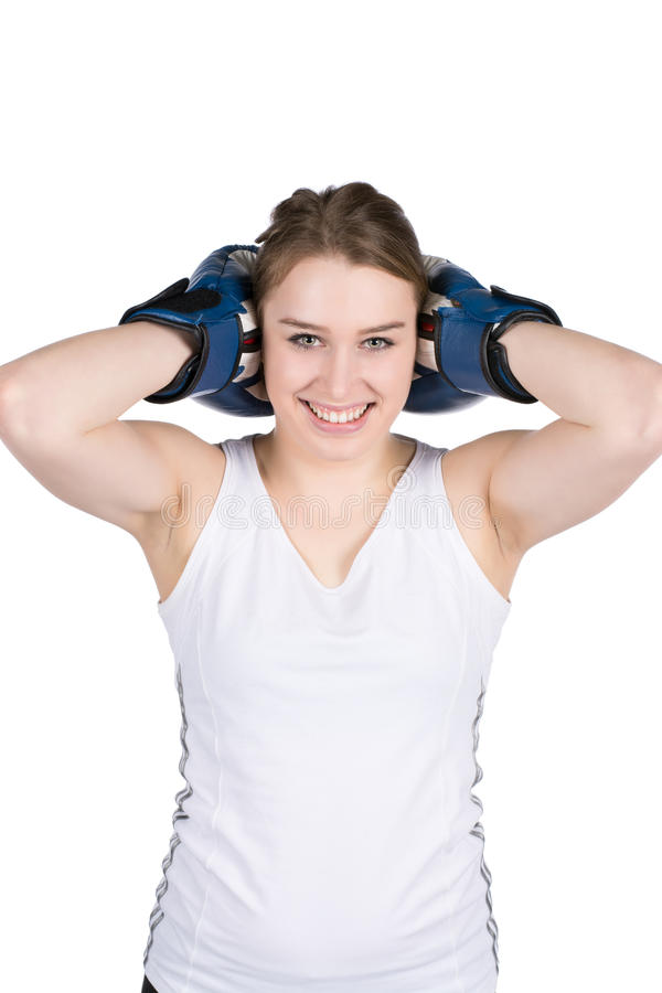 Woman holds boxing gloves against her head stock images