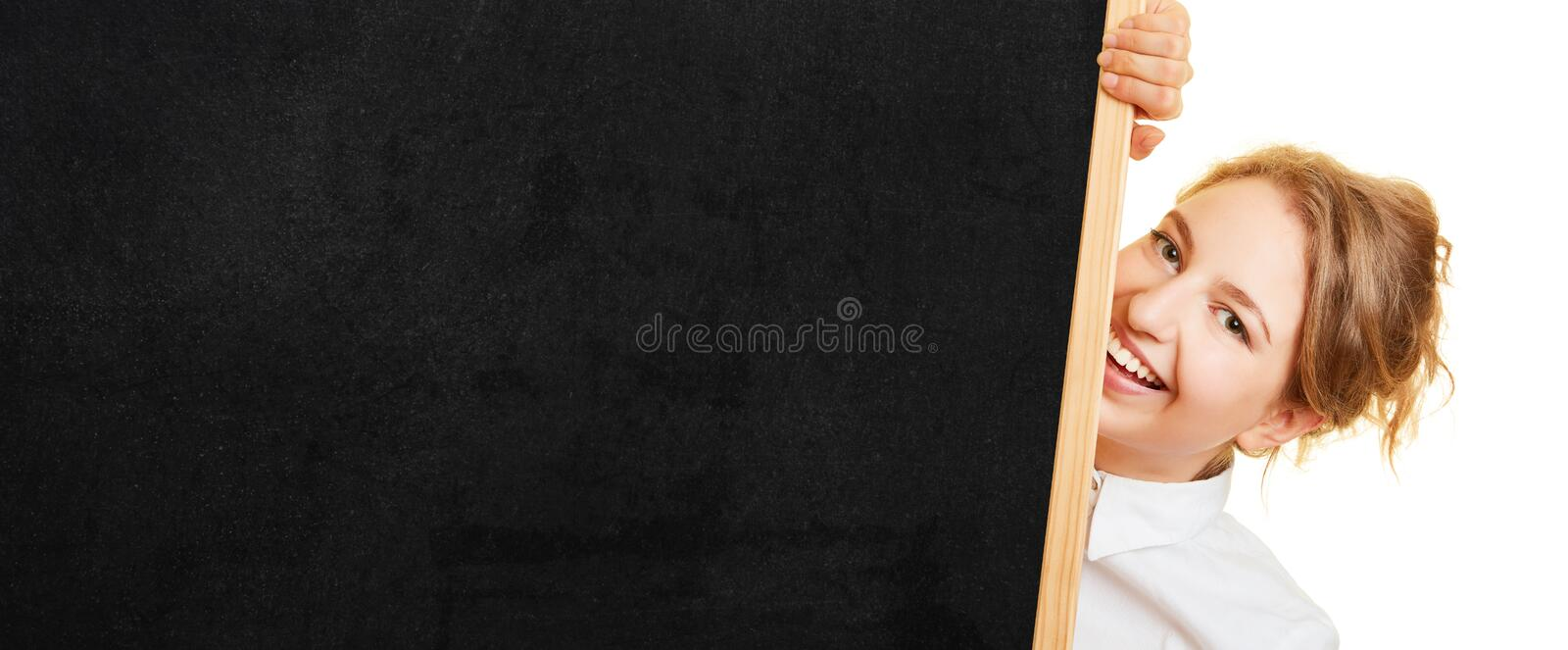 Woman holds chalkboard background with copy space. Young blond woman holds chalkboard background with copy space stock images