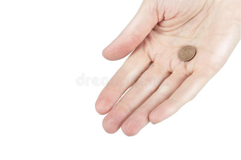 Woman holds a coin in a palm, single coin in a hand of person stock images
