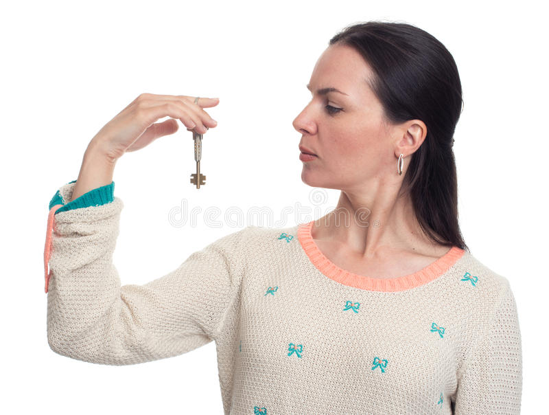 Woman holds keys in a hand royalty free stock photo