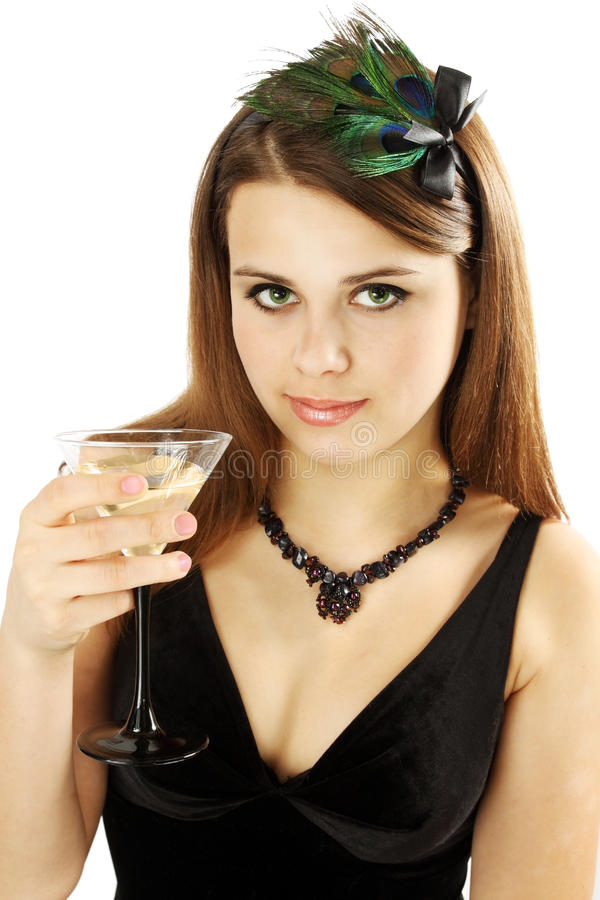 Woman holds Martini. Woman in the feathers and the necklace holds Martini stock images