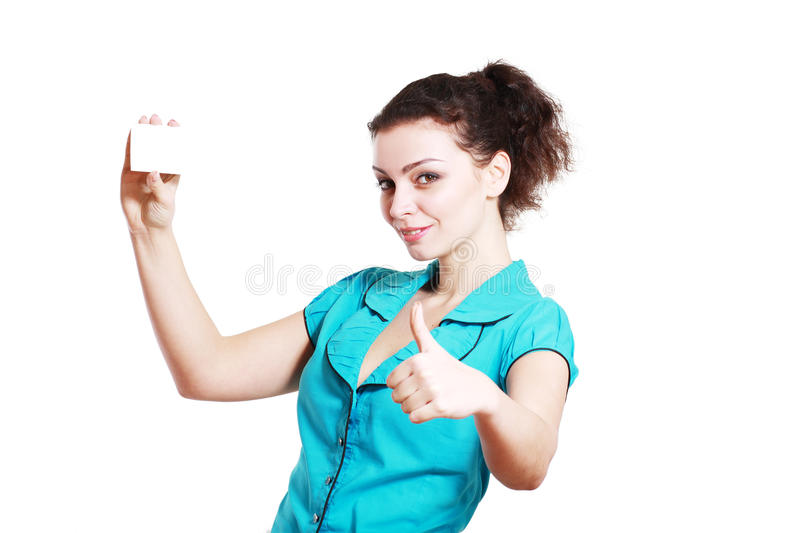 Woman holds out a business or credit. A beautiful woman holds out a business or credit card Isolated on white background stock photography