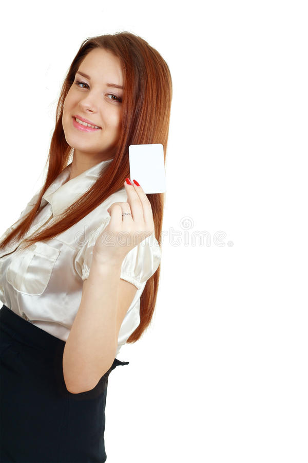 Woman holds out a business or credit card. A beautiful woman holds out a business or credit card Isolated on white background royalty free stock image