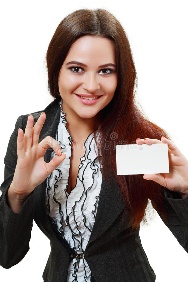 Woman holds out a business or credit card. A beautiful woman holds out a business or credit card Isolated on white background stock photo