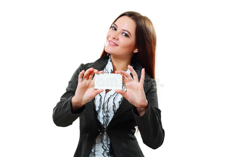 Woman holds out a business or credit card. A beautiful woman holds out a business or credit card Isolated on white background royalty free stock images
