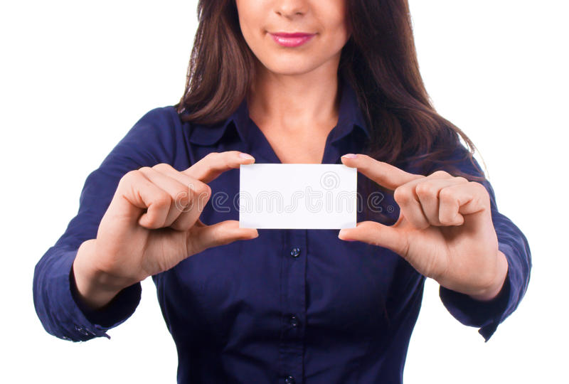 Woman holds out a business or credit card on white. Background stock photo