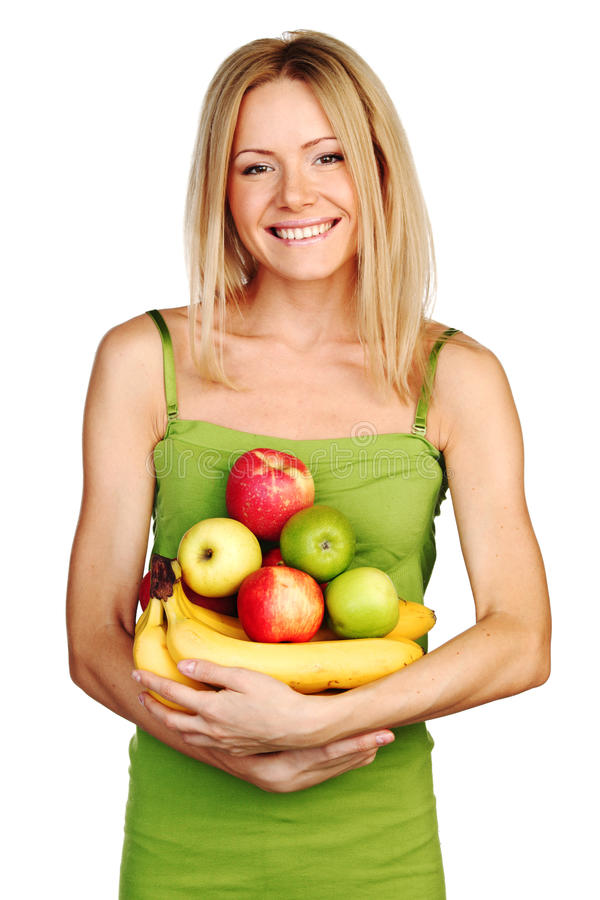 Woman holds a pile of fruit royalty free stock photos