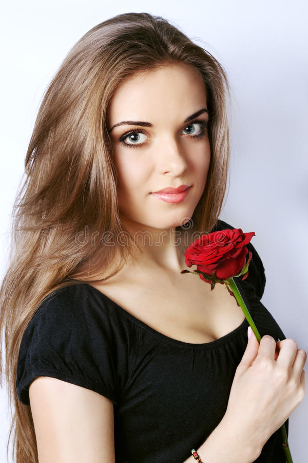 Download Woman holds a red rose stock photo. Image of background - 29596160