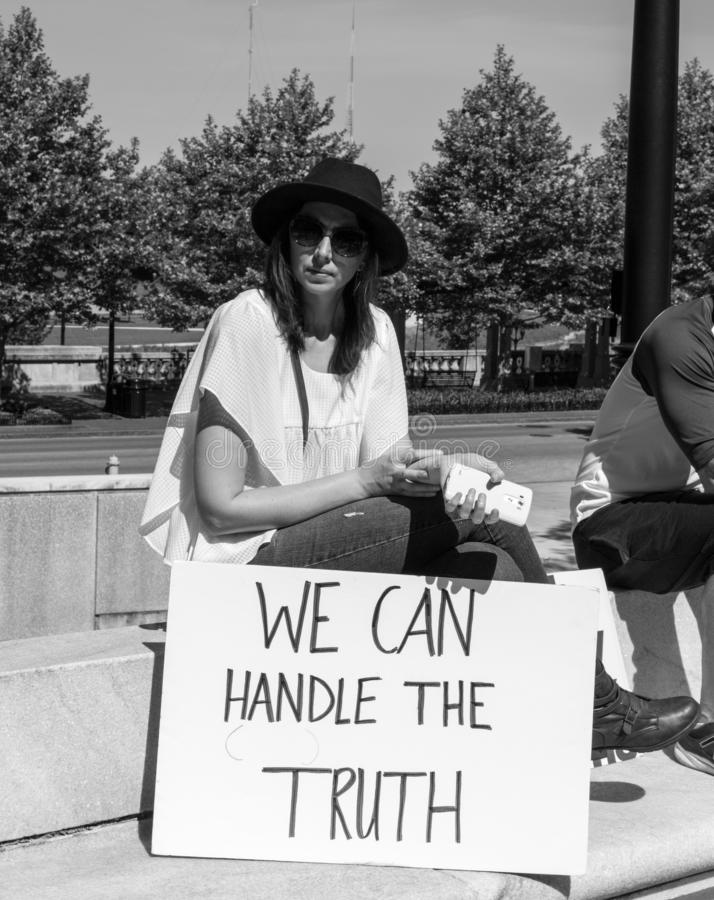 Woman Holds Sign Saying We Can Handle the Truth at Anti-Trump Rally stock image
