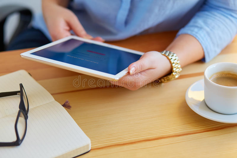 Woman holds a tablet with online banking stock images
