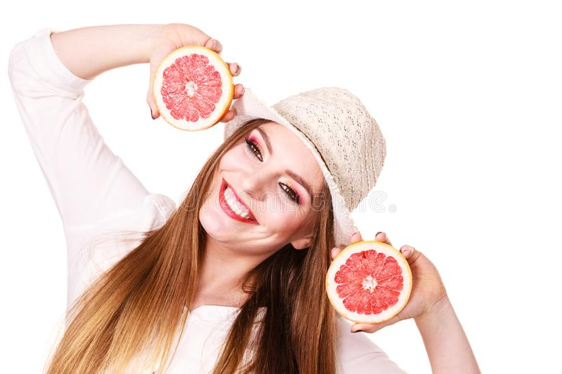 Woman holds two halfs of grapefruit citrus fruit in hands royalty free stock image